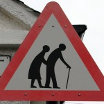 old couple roadsign